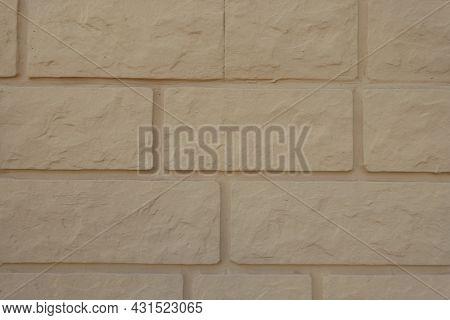 Closeup Of Pale Yellow Brick Veneer Wall