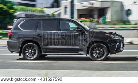 Moscow, Russia - July 2021: Side View Of Lexus Lx 570 Third Generation J200 Suv In Motion. Black Big