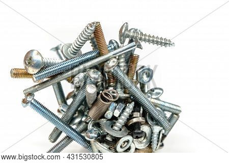 Bolts, Nuts And Springs On White Background