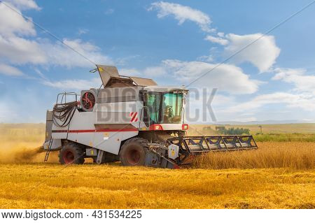 Agricultural Machine Harvester For Harvesting Ripe Grain Crops. Rotary Combine Working In The Wheat