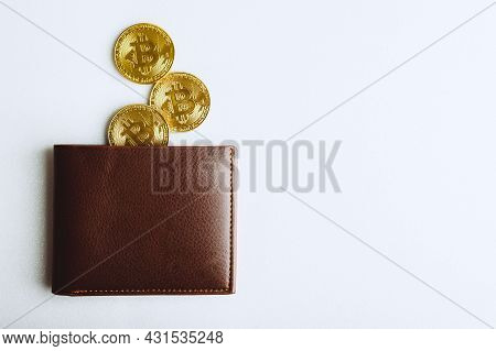 There Is Bitcoin Coin In Wallet Pocket. Crypto Currency In Your Wallet