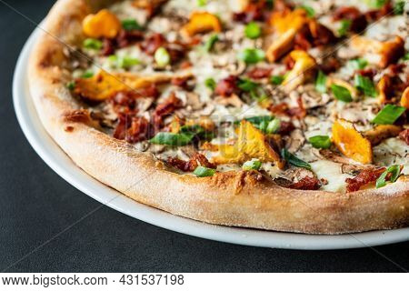 tasty pizza with chanterelles and vegetables