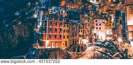 Colorful houses of Riomaggiore village at night, Cinque Terr,. Italy