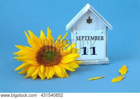 Calendar For September 11 : Decorative House With The Name Of The Month In English, Number 11, Yello