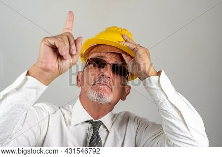 Portrait Of Businessman With Protective Hat And Sun Glasses