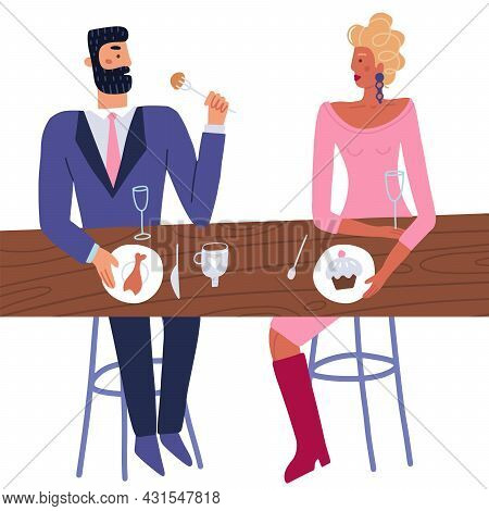 Couple Enjoy Romantic Date Together In Restuarant. Man In Suit And Woman In Dress Sitting At Table A