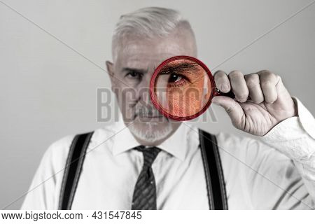 Portrait Of Investigator While Looking With Magnifying Glass