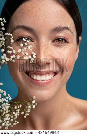 Beauty Natural Smiling Woman With Freckles, Clean And Healthy Glowing Skin. Concept Of Sunscreen Lot