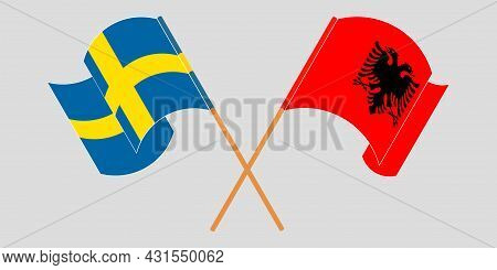 Crossed And Waving Flags Of Albania And Sweden