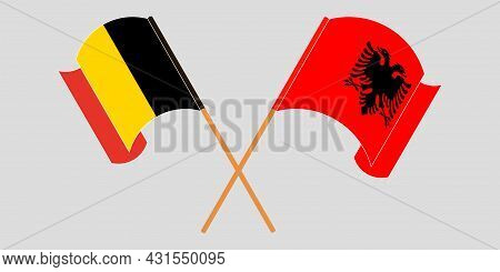 Crossed And Waving Flags Of Albania And Belgium