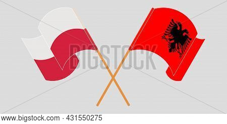 Crossed And Waving Flags Of Albania And Poland