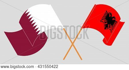 Crossed And Waving Flags Of Albania And Qatar