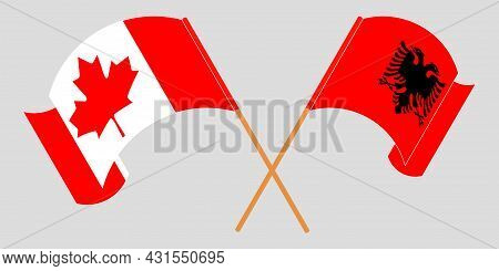 Crossed And Waving Flags Of Albania And Canada