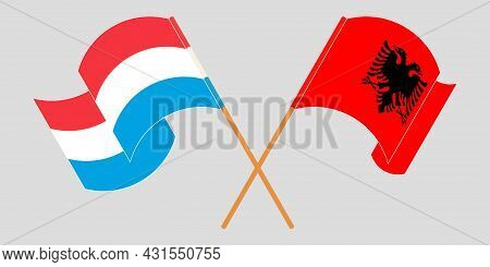 Crossed And Waving Flags Of Albania And Luxembourg