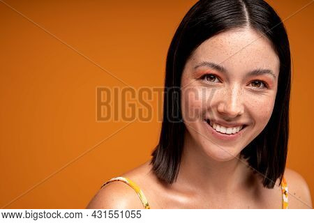 Young Natural Woman With Beauty Face . Beautiful Smiling Girl Model With Delicate Makeup And A Lot O