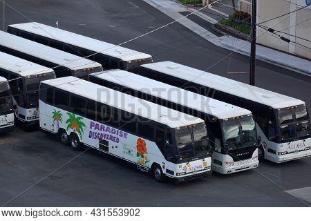 Honolulu - August 25, 2014: Overhead View Of Row Of Parked Paradise Discovered Buses On Oahu, Hawaii