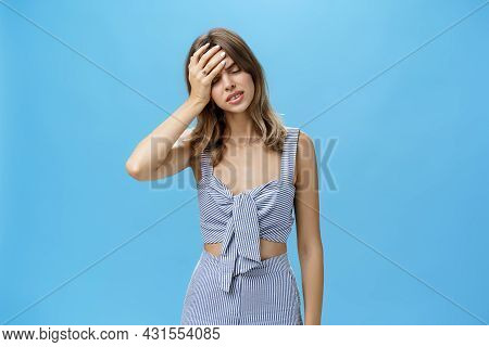 Woman Feeling Tired And Concerned, Filled With Troubles Making Facepalm Gesture, Punching Forehead W