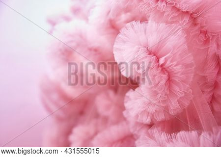 Texture Pink Background From The Airy Fabric Of The Dress. Copy Space For Text About Design And Fash