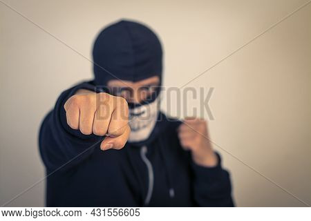 Fist Punch, A Man In A Black And White Mask Giving A Punch.