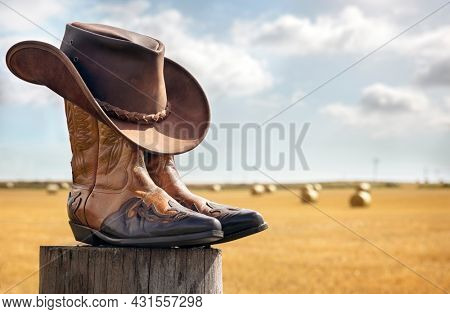 Cowboy boots and hat at ranch, country music festival live concert or line dancing concept