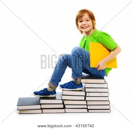 Clever Boy On Pile Of Books