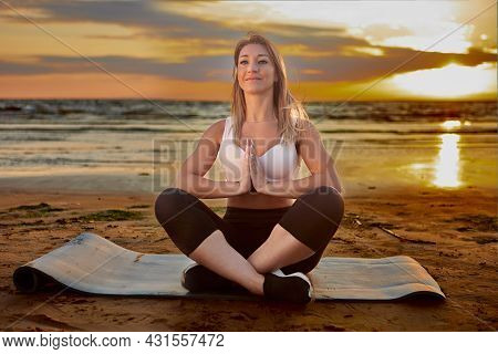 Yoga Exercises During Sunset By Smiling Woman On Coast.
