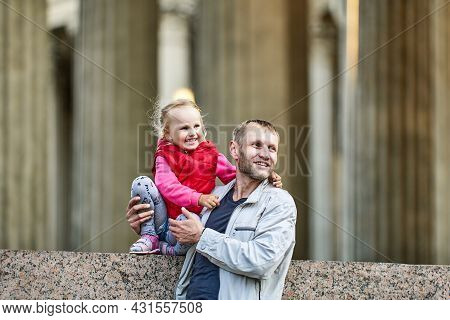 Happy Toddler Girl With Father Walks Near Museum.