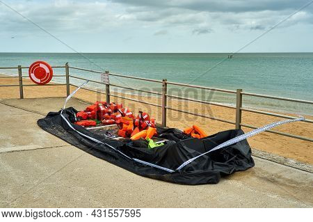 A Deflated Rubber Dinghy Used By Migrants. A Rubber Dinghy Used By Migrants To Cross The English Cha