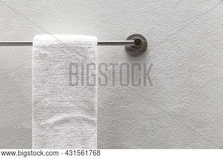 Clean White Towels Hang On Stainless Steel Rails In The Bathroom