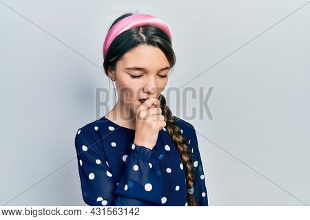 Young brunette girl wearing elegant look feeling unwell and coughing as symptom for cold or bronchitis. health care concept.
