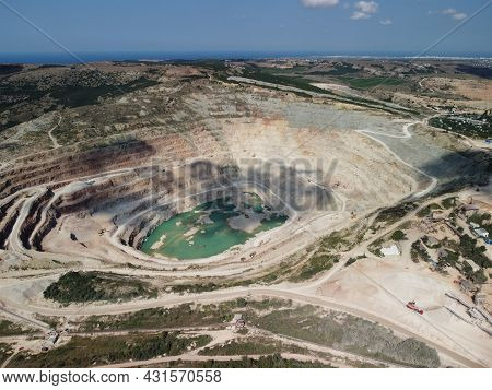 Aerial View Industrial Of Opencast Mining Quarry With Lots Of Machinery At Work - Extracting Fluxes
