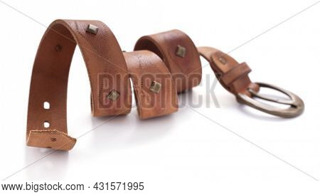 Brown leather belt isolated on white background. Old shabby belt