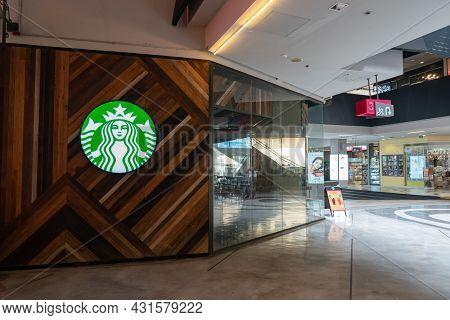Bangkok, Thailand - 30 Apr 2021, Starbuck Logo On Round Light Box At Art Wood Pattern Design In Fron