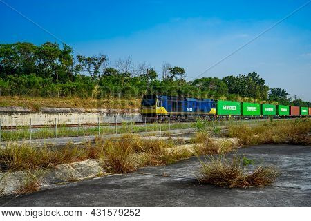 Chonburi Province, Thailand - 21 Nov 2020, The Evergreen Container On The Train Is Driven On Rural R