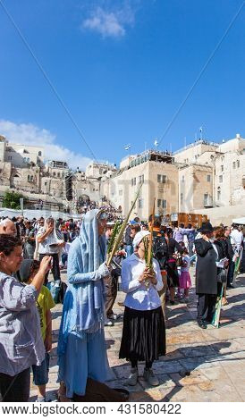 JERUSALEM, ISRAEL - NOVEMBER 16, 2011: Great religious Jewish holiday. The Western Wall - place of faith and pilgrimage for Jews around the world. Israel, Jerusalem, the Temple Mount.