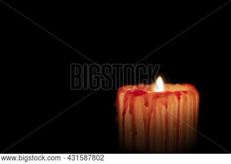 Bloody White Candle With Red Streaks Burns In Darkness Night Isolated On Black. Concept Of Grief, Sa