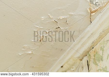 Broken Plaster On The Ceiling After A Water Leak From The Upper Floor