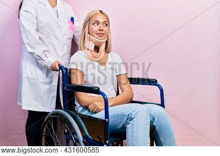 Beautiful blonde woman sitting on wheelchair with collar neck smiling looking to the side and staring away thinking.