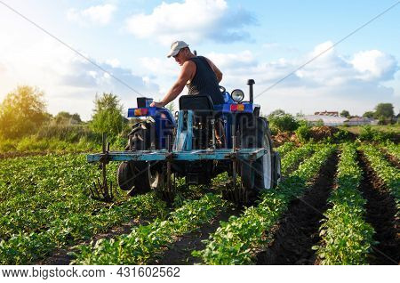 The Farmer Works In The Field With A Tractor. Agroindustry And Agribusiness. Farming Machinery. Plow