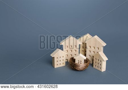 Family Home Concept. Residential Buildings And Houses In A Bird's Nest. Parenting Metaphor. Investin
