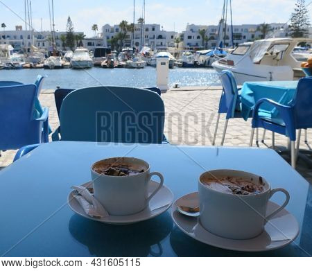 Two Cups Of Coffee With Ice Cream And Dessert Tubes In Front Of The Port El Kantaoui Resort In Tunis
