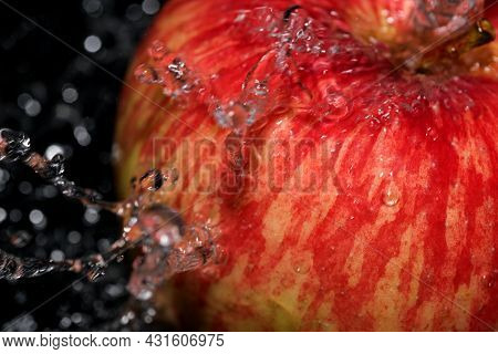 Red Ripe Sweet Apple Under A Stream Of Clean Water Close-up Macro Photography