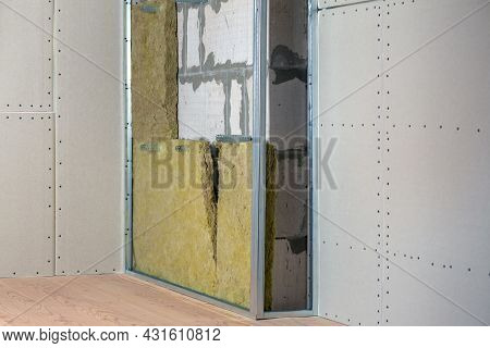 Wall Of A Room Under Renovation With Mineral Rock Wool Insulation And Metal Frame Prepared For Drywa