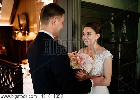 Bride And Groom In Doorway During First Meeting Before Wedding Ceremony