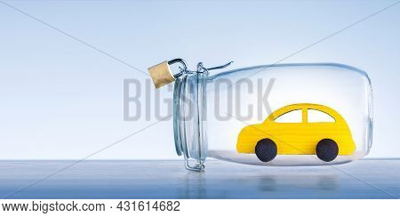 Car Insurance Banner Concept. Yellow Toy Car Protected Under A Glass Dome.