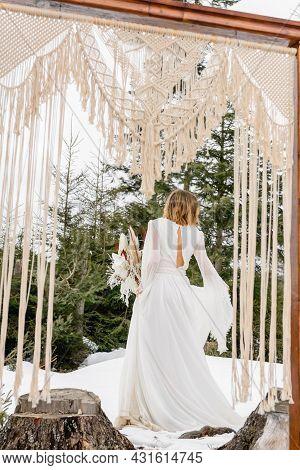 Vorokhta, Ukraine March 31, 2021: Portrait Of The Bride, Winter Walk And Portrait Photography.