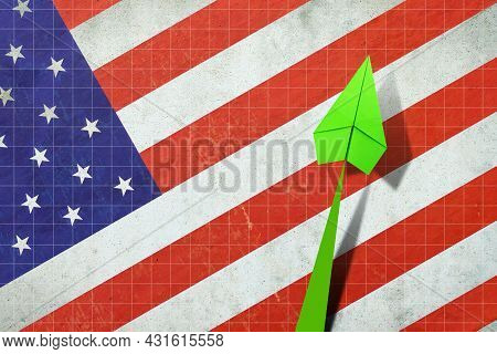 Upward Arrow On The Background Of The Flag Of America. Paper Airplane. Economic Recovery. Copy Space
