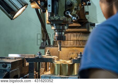 The Machine Operator Drilling The Hole On Metal Plate With Nc Milling Machine. The Shop Floor Operat