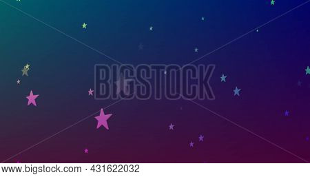 Image of multiple glowing rainbow coloured stars moving in hypnotic motion on blue background. Colour and movement concept digitally generated image.