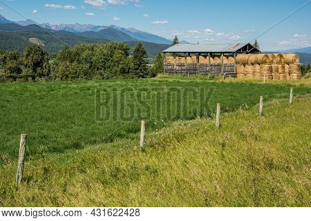 Country Life In Canada. Nature, Blue Sky. Farm, Hay Supply Under Canopy